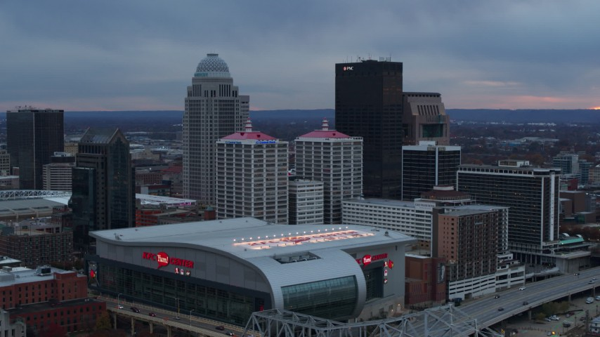 5.7K stock footage aerial video flyby arena and city skyline at sunset, Downtown Louisville, Kentucky Aerial Stock Footage | DX0001_003083