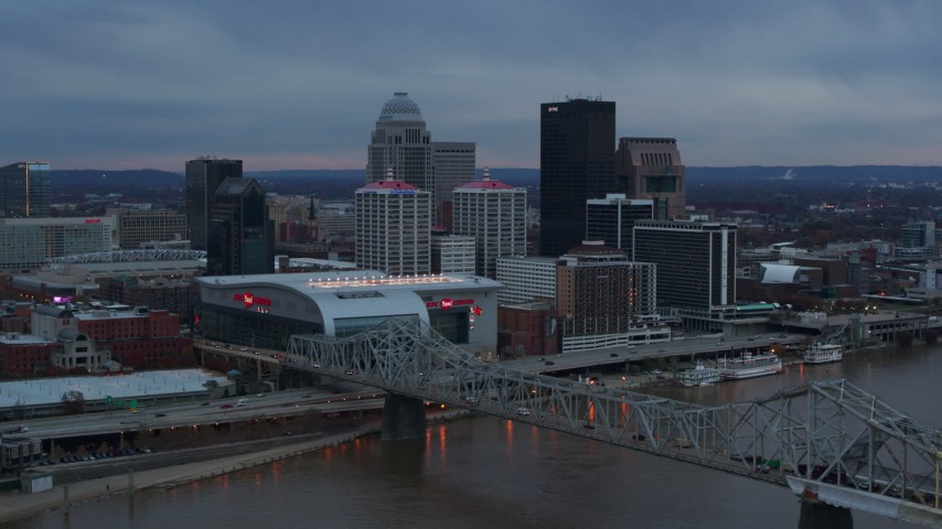 5.7K aerial video of the arena and city skyline at sunset, seen from near the bridge, Downtown Louisville, Kentucky Aerial Stock Footage | DX0001_003085