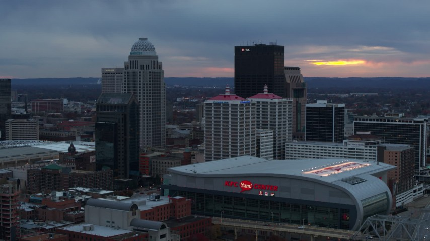 5.7K stock footage aerial video fly away from the arena and city skyline at sunset, Downtown Louisville, Kentucky Aerial Stock Footage | DX0001_003087