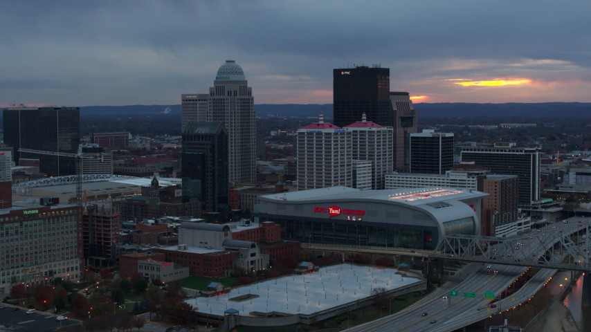 5.7K aerial video flyby the arena and city skyline at sunset, Downtown Louisville, Kentucky Aerial Stock Footage | DX0001_003088