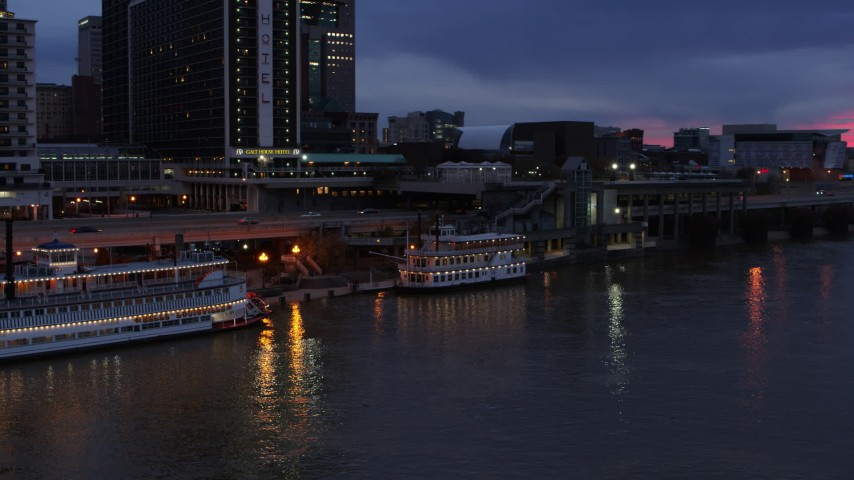 5.7K stock footage aerial video orbit small riverboat at twilight in Downtown Louisville, Kentucky Aerial Stock Footage DX0001_003093 | Axiom Images