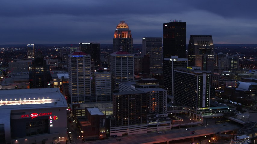 5.7K stock footage aerial video of approaching the skyline lit up at twilight, Downtown Louisville, Kentucky Aerial Stock Footage | DX0001_003099