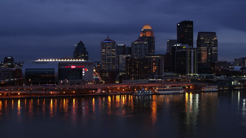 5.7K stock footage aerial video approach the skyline and arena lit up at twilight from the Ohio River, Downtown Louisville, Kentucky Aerial Stock Footage | DX0001_003103