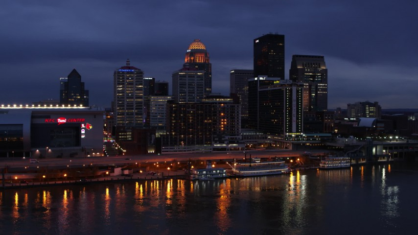 5.7K stock footage aerial video stationary view of the skyline lit up at twilight, seen from Ohio River, Downtown Louisville, Kentucky Aerial Stock Footage | DX0001_003104