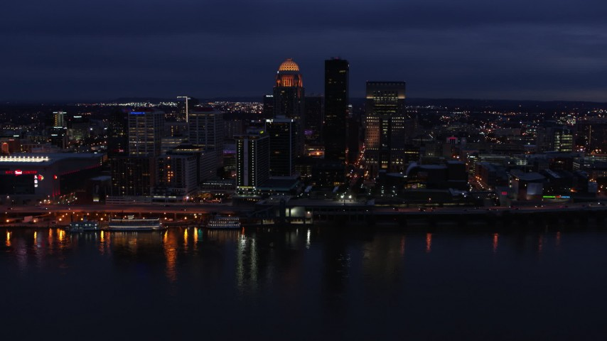 5.7K stock footage aerial video slowly pass the city's skyline at twilight, seen from across Ohio River, Downtown Louisville, Kentucky Aerial Stock Footage | DX0001_003109