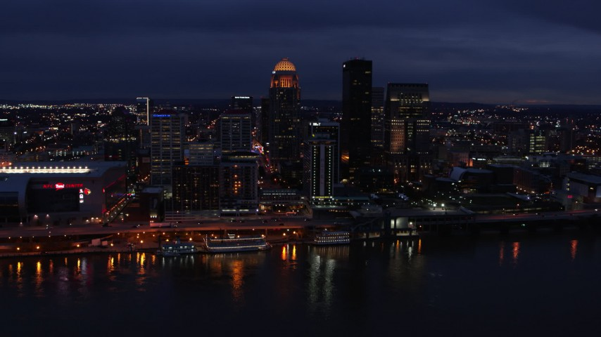 5.7K aerial video slowly flyby the city's skyline at twilight, seen from across Ohio River, Downtown Louisville, Kentucky Aerial Stock Footage | DX0001_003110
