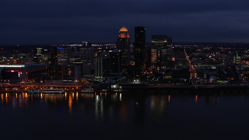 5.7K aerial video of the city's skyline at twilight, seen from Ohio River, Downtown Louisville, Kentucky Aerial Stock Footage DX0001_003112