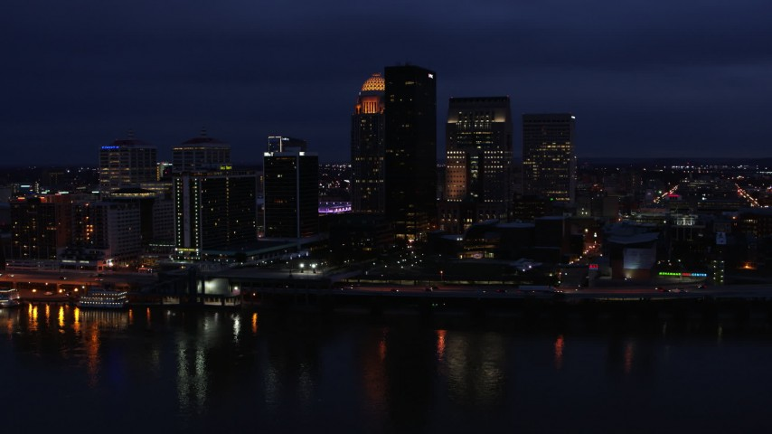 5.7K aerial video approach the city's skyline at twilight from the Ohio River, Downtown Louisville, Kentucky Aerial Stock Footage | DX0001_003113