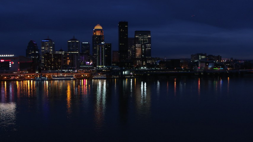 5.7K stock footage aerial video of the city skyline at twilight across the river, Downtown Louisville, Kentucky Aerial Stock Footage | DX0001_003116
