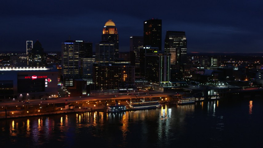 5.7K aerial video slowly fly away from the city skyline at twilight, seen from the river, Downtown Louisville, Kentucky Aerial Stock Footage | DX0001_003119