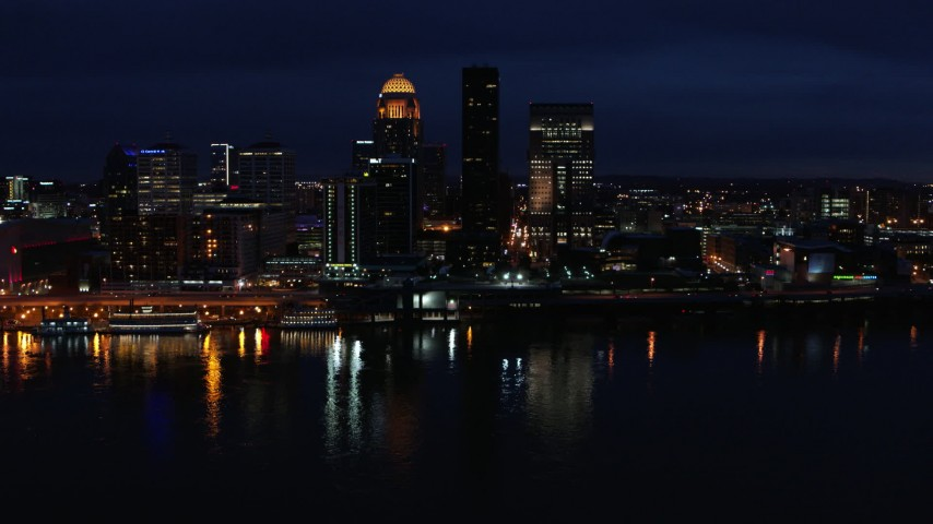 5.7K aerial video slowly flying past the city skyline at twilight, seen from the river, Downtown Louisville, Kentucky Aerial Stock Footage | DX0001_003120