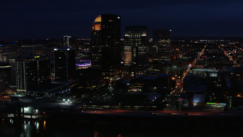 5.7K stock footage aerial video flying by the city's skyline at twilight, Downtown Louisville, Kentucky Aerial Stock Footage | DX0001_003122