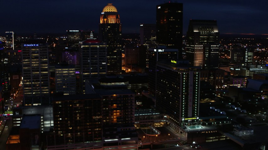 5.7K aerial video passing by the city's skyline at twilight, Downtown Louisville, Kentucky Aerial Stock Footage | DX0001_003123
