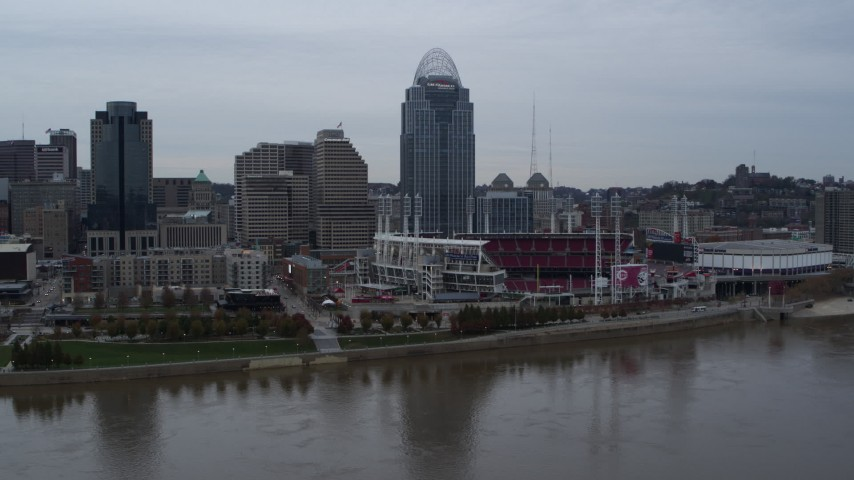 5.7K stock footage aerial video slow pass over river with view of the baseball stadium and skyscraper, Downtown Cincinnati, Ohio Aerial Stock Footage | DX0001_003129
