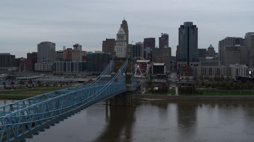5.7K aerial video ascend by Roebling Bridge to approach the city's skyline, Downtown Cincinnati, Ohio Aerial Stock Footage | DX0001_003134