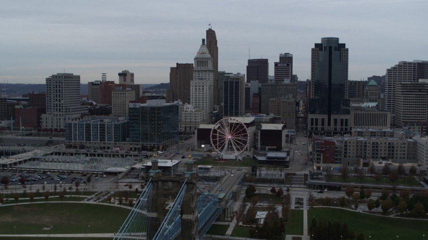 5.7K aerial video reverse view of city's skyline, reveal the bridge and river, Downtown Cincinnati, Ohio Aerial Stock Footage | DX0001_003135