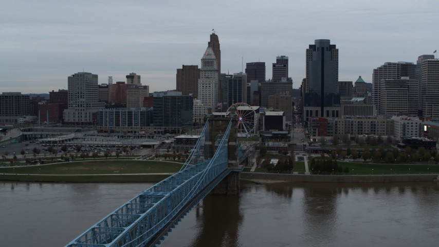 5.7K stock footage aerial video ascend by bridge while focused on the city skyline, Downtown Cincinnati, Ohio Aerial Stock Footage | DX0001_003139