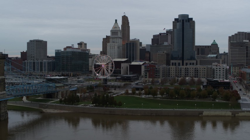 5.7K stock footage aerial video fly over Ohio River to approach Ferris wheel and skyline, Downtown Cincinnati, Ohio Aerial Stock Footage | DX0001_003141