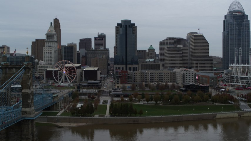 5.7K aerial video fly over Ohio River to approach tall skyscraper, Downtown Cincinnati, Ohio Aerial Stock Footage | DX0001_003143