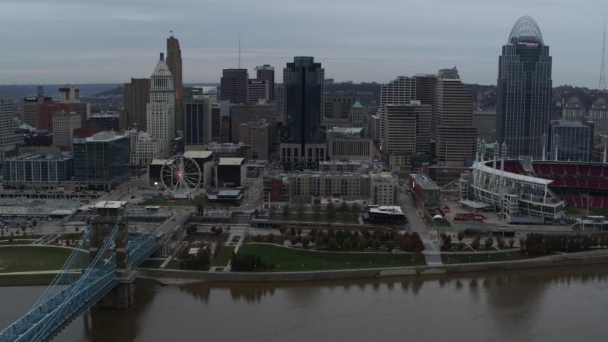 5.7K aerial video slow pass by city skyline, seen from the Ohio River near bridge, Downtown Cincinnati, Ohio Aerial Stock Footage | DX0001_003145