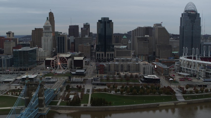 5.7K stock footage aerial video slow approach to city skyline and Scripps Center from the Ohio River, Downtown Cincinnati, Ohio Aerial Stock Footage | DX0001_003146