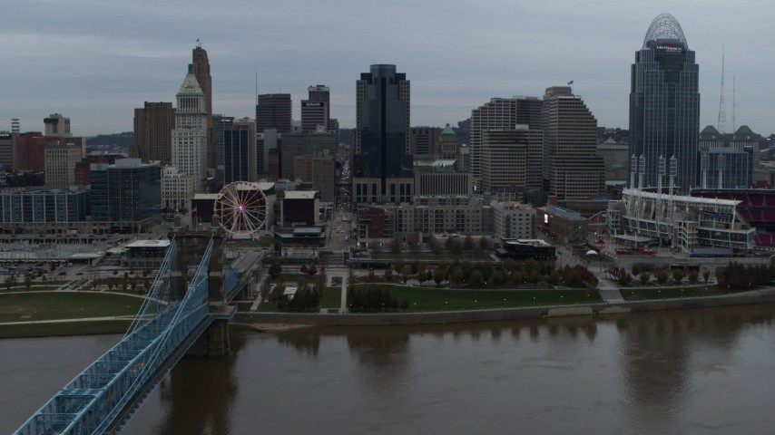 5.7K stock footage aerial video descend toward the river by bridge while focused on skyline, Downtown Cincinnati, Ohio Aerial Stock Footage | DX0001_003149