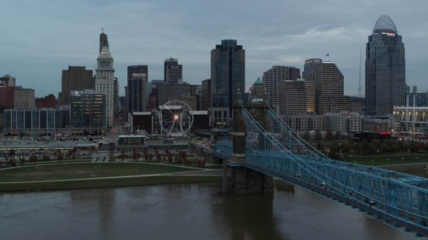 5.7K aerial video follow bridge over the river toward the city skyline at sunset, Downtown Cincinnati, Ohio Aerial Stock Footage | DX0001_003151
