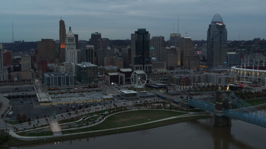 5.7K stock footage aerial video of the city skyline seen from the Roebling Bridge over the river at sunset, Downtown Cincinnati, Ohio Aerial Stock Footage | DX0001_003153