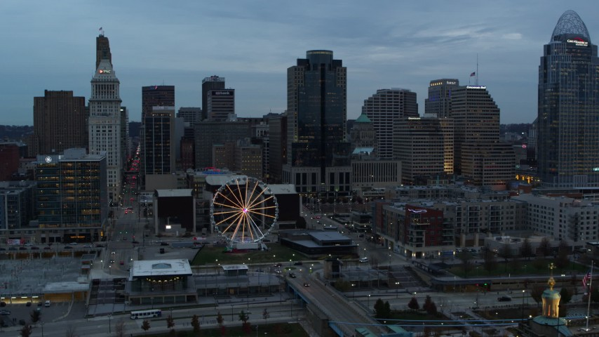 5.7K stock footage aerial video flying by the Ferris wheel and city skyline at sunset, Downtown Cincinnati, Ohio Aerial Stock Footage | DX0001_003155