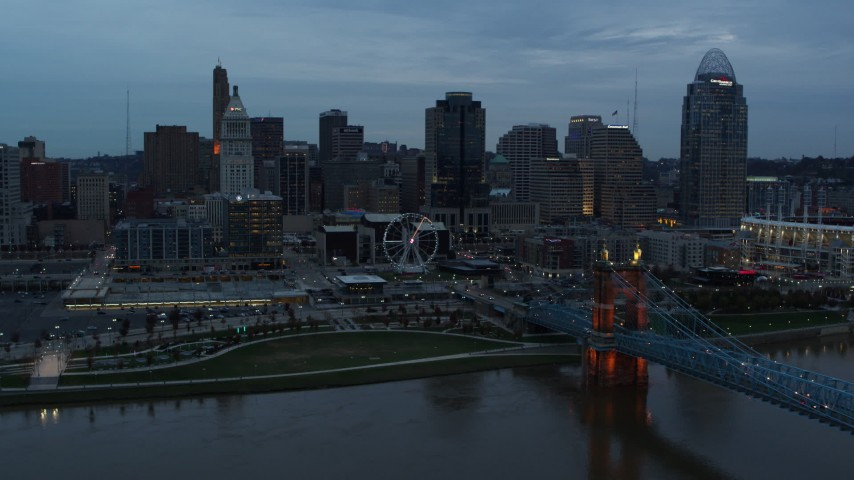 5.7K aerial video passing the city skyline at sunset, seen from Ohio River, Downtown Cincinnati, Ohio Aerial Stock Footage | DX0001_003159