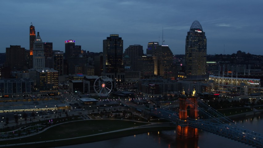5.7K aerial video ascend over Ohio River at twilight with view of bridge and skyline, Downtown Cincinnati, Ohio Aerial Stock Footage | DX0001_003163