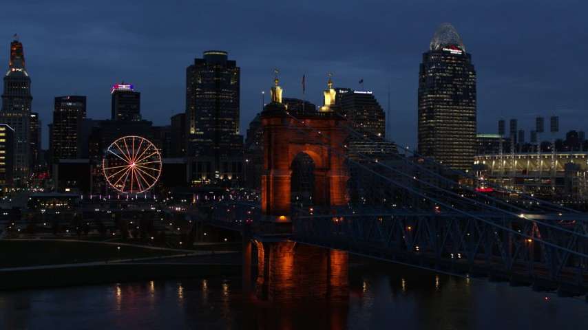 5.7K stock footage aerial video approach end of Roebling Bridge and city skyline lit up at twilight, Downtown Cincinnati, Ohio Aerial Stock Footage | DX0001_003176