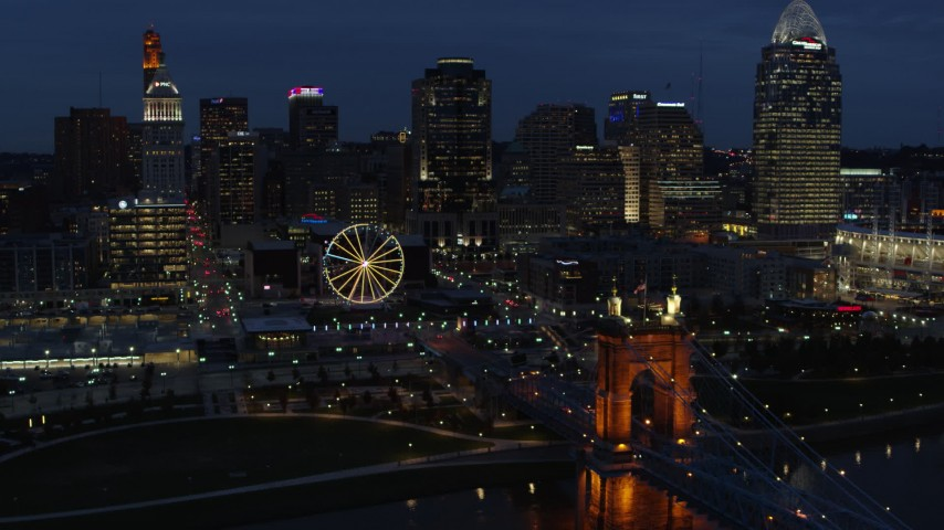5.7K aerial video fly over Ohio River to approach Ferris wheel and skyline at twilight, Downtown Cincinnati, Ohio Aerial Stock Footage | DX0001_003184