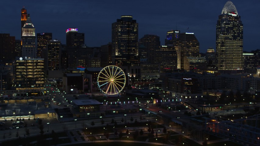 5.7K stock footage aerial video flying by Ferris wheel and skyscrapers at twilight, Downtown Cincinnati, Ohio Aerial Stock Footage | DX0001_003185