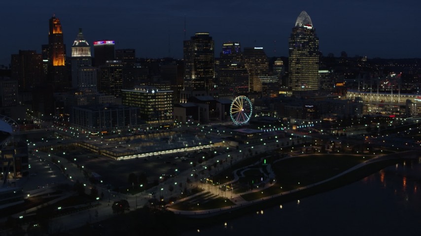 5.7K stock footage aerial video reverse view of Ferris wheel and skyscrapers at twilight, reveal river, Downtown Cincinnati, Ohio Aerial Stock Footage | DX0001_003186