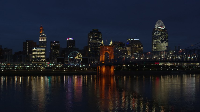 5.7K stock footage aerial video stationary view of the city's skyline across the Ohio River at twilight, Downtown Cincinnati, Ohio Aerial Stock Footage | DX0001_003190