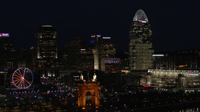 5.7K stock footage aerial video of passing by tall skyscrapers and Ferris wheel at night in Downtown Cincinnati, Ohio Aerial Stock Footage | DX0001_003193