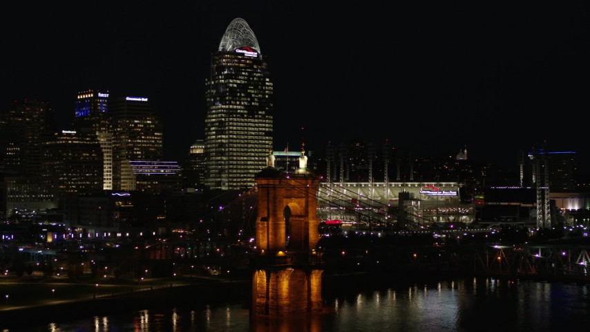 5.7K stock footage aerial video orbit Roebling Bridge at night with city skyline in background, Downtown Cincinnati, Ohio Aerial Stock Footage | DX0001_003199