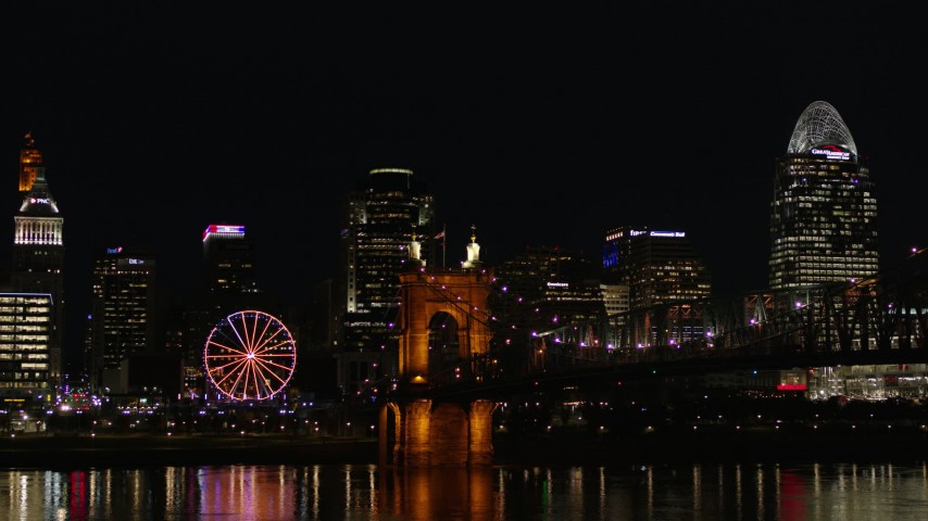 5.7K stock footage aerial video of the Roebling Bridge at night with city skyline in background, Downtown Cincinnati, Ohio Aerial Stock Footage | DX0001_003202