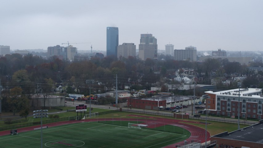 5.7K stock footage aerial video ascend from football field for view of the city skyline, Downtown Lexington, Kentucky Aerial Stock Footage | DX0001_003203