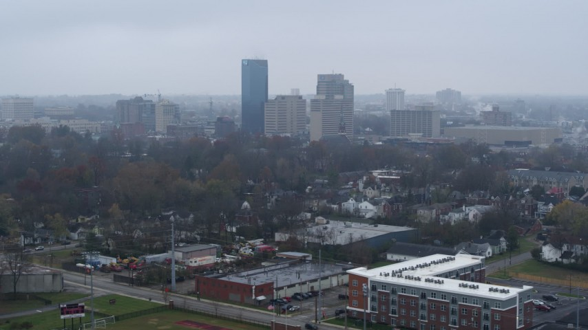 5.7K stock footage aerial video of a view of the city skyline from residential neighborhoods, Downtown Lexington, Kentucky Aerial Stock Footage   DX0001_003204
