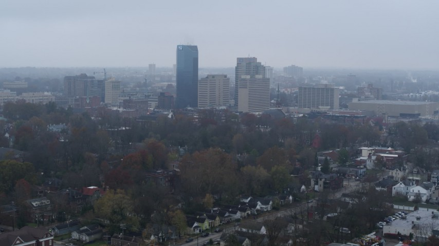 5.7K aerial video flying by the city skyline seen from residential neighborhoods, Downtown Lexington, Kentucky Aerial Stock Footage | DX0001_003206