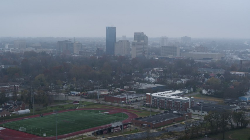 5.7K stock footage aerial video reverse view of the city skyline seen from residential neighborhoods, Downtown Lexington, Kentucky Aerial Stock Footage | DX0001_003207