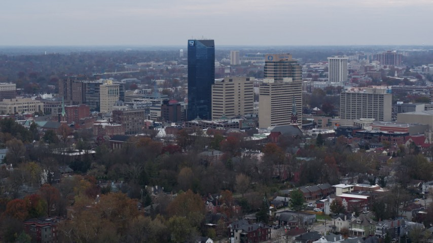5.7K stock footage aerial video flyby and approach the city's skyline from tree-lined neighborhoods, Downtown Lexington, Kentucky Aerial Stock Footage | DX0001_003215