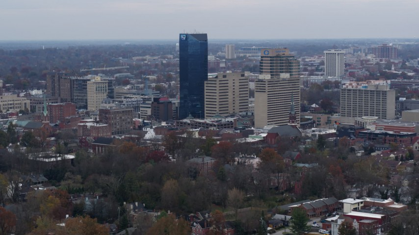 5.7K stock footage aerial video slowly flyby the city's skyline before flying away in Downtown Lexington, Kentucky Aerial Stock Footage | DX0001_003218