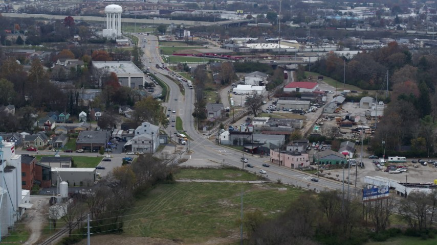 5.7K stock footage aerial video passing a busy street in industrial area near water tower in Lexington, Kentucky Aerial Stock Footage | DX0001_003222