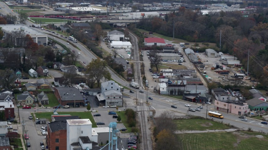 5.7K stock footage aerial video passing a busy street and railroad tracks in industrial area in Lexington, Kentucky Aerial Stock Footage | DX0001_003223
