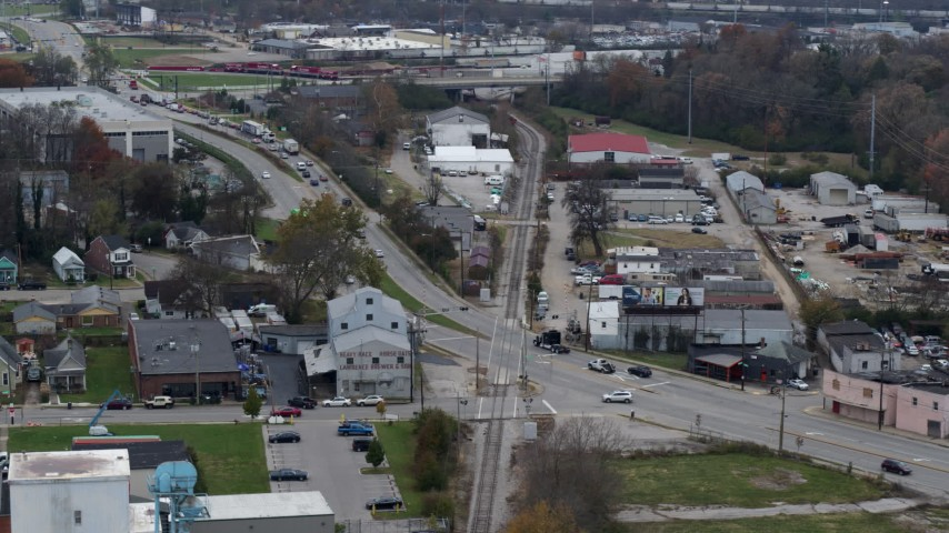 5.7K stock footage aerial video reverse view of a busy street and railroad tracks in industrial area in Lexington, Kentucky Aerial Stock Footage | DX0001_003224