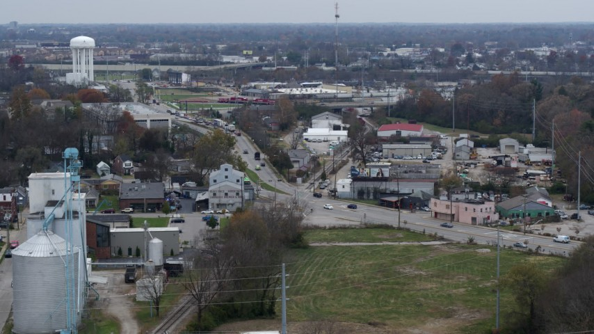 5.7K stock footage aerial video reverse view of a busy street and railroad tracks in industrial area and descend in Lexington, Kentucky Aerial Stock Footage | DX0001_003225