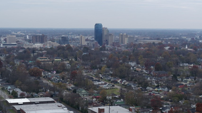 5.7K stock footage aerial video ascend from neighborhood and focus on city skyline, Downtown Lexington, Kentucky Aerial Stock Footage | DX0001_003226